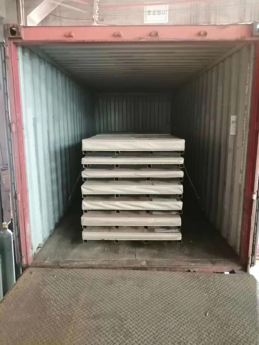 Export of colored stainless steel sheets into containers